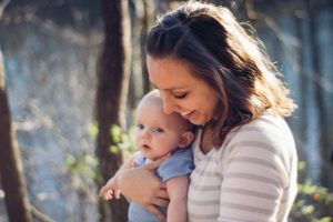 Adoptive mom holding baby, after going through the adoption process